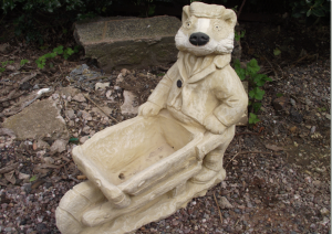 Stone Badger Pushing a Wheelbarrow Planter