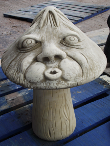 Stone Mushroom Statue Whistling Man