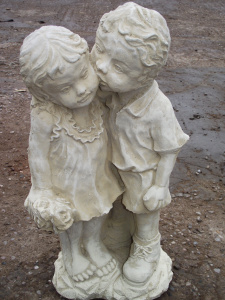 Stone Boy and Girl First Kiss Statue