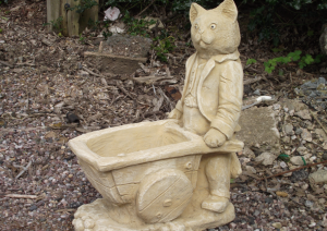Stone Cat Pushing a Barrow