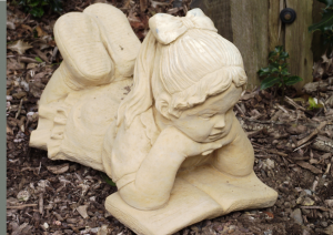Stone Girl Statue Reading a Book